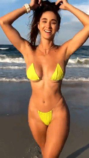 Brunette in revealing yellow bikini loves to show off