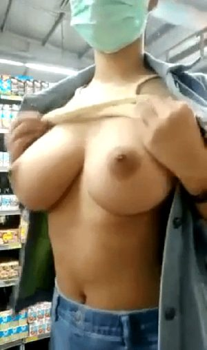 Playing with her tits at the grocery store